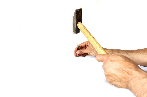 driving a screw with a tack hammer