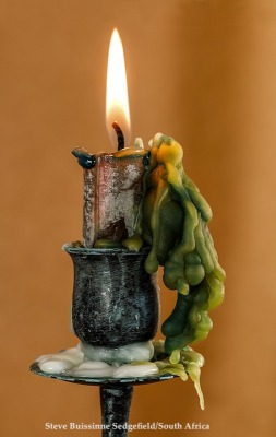Candle with wax exclsions